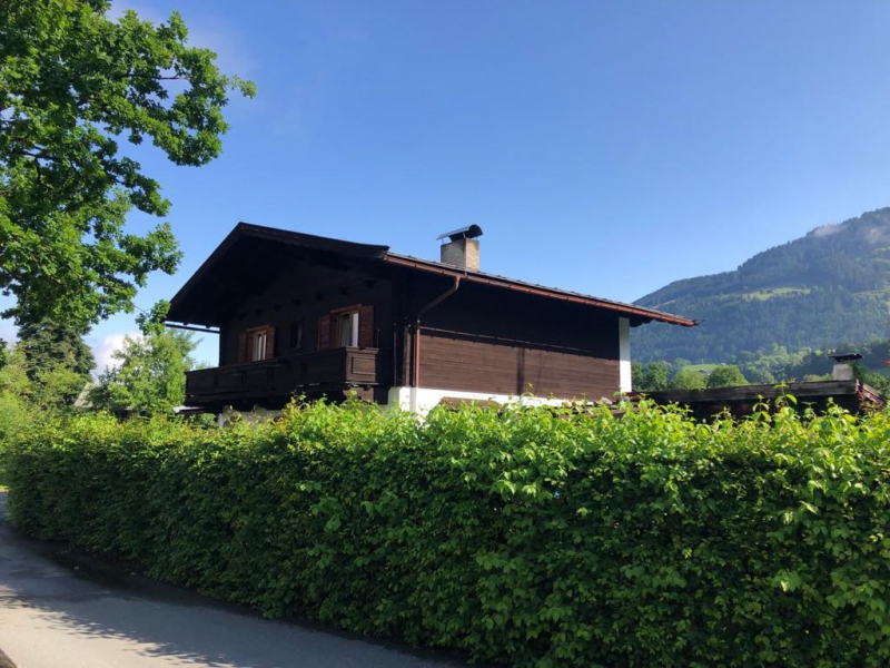 Exklusive Wohnlage – Südausrichtung – Traumhafter Blick: Grundstück mit Haus am Fuße der Bichlalm /  / 6370Kitzbühel / Bild 1